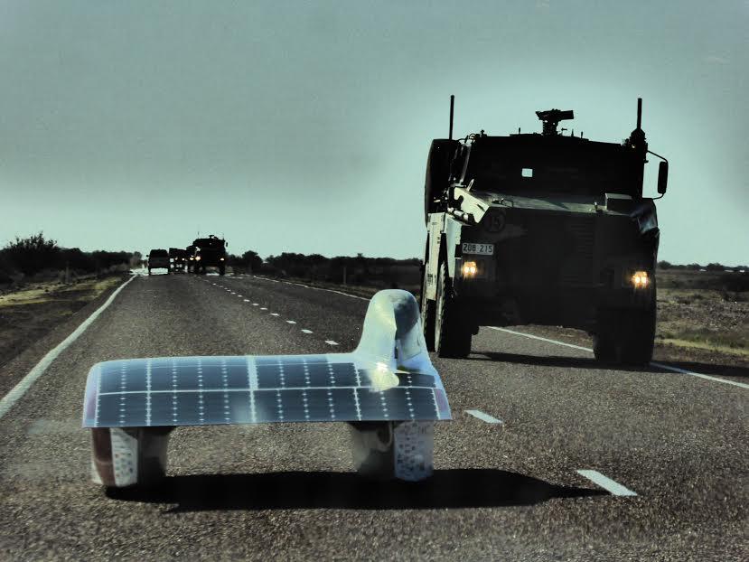 Arctan passing an Australian military convoy during testing. Photo Credits Kelsey Josund.